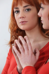 Redhead looking in a mirror