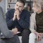 Wife supporting husband in therapy